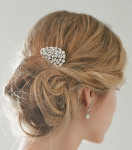 The Ava Hair Comb is a brass and CZ hair comb from our Bridal Jewelry Collection seen here on model.
