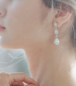 The Ava Halo Drops are sterling silver and CZ earrings from our Bridal Jewelry Collection seen here on model.