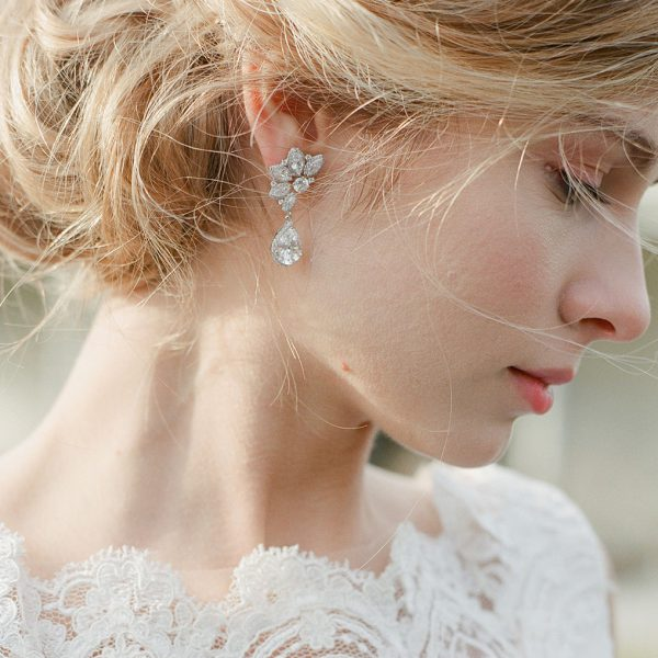 The Ava Halo Teardrops are sterling silver and CZ earrings from our Bridal Jewelry and Evening Jewelry Collections seen here on model.