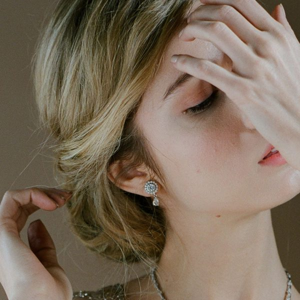 The Ava Petite Teardrops are sterling silver and CZ earrings from our Bridal Jewelry Collection seen here on model.