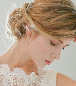 The Ava Teardrops are sterling silver and CZ earrings from our Bridal Jewelry Collection seen here on model.