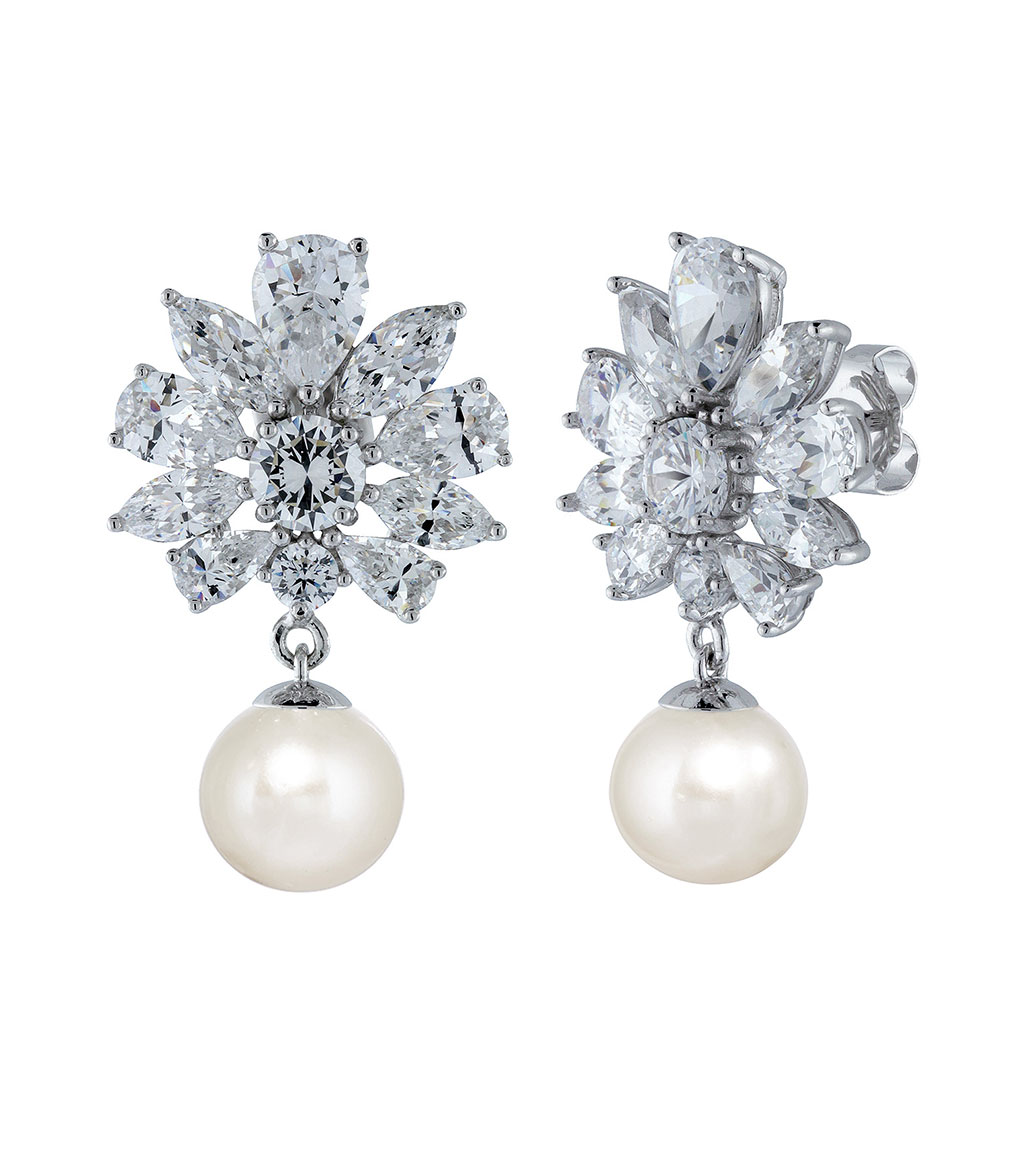 The Floral Pearl Drops are sterling silver freshwater pearl and CZ earrings featured in our Bridal Jewelry Collection.