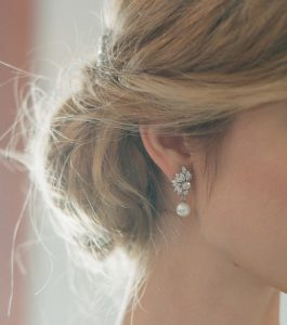 The Grace Marquise Burst Pearl Drops are sterling silver freshwater pearl and CZ earrings featured in our Bridal Jewelry and Evening Jewelry Collections seen here on model.