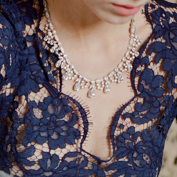 The Grace Pear Statement Necklace is a sterling silver and CZ necklace from our Bridal Jewelry and Evening Jewelry Collections seen here on model.