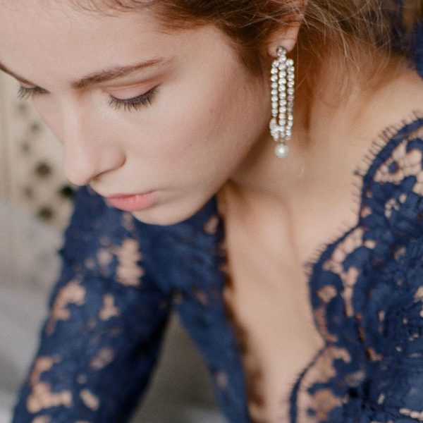 The Grace Round Pearl Chandeliers are sterling silver freshwater pearl and CZ earrings from our Bridal Jewelry and Evening Jewelry Collections seen here on model.