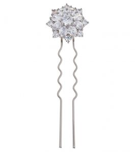 The Liz Garland Burst Hairpin is a brass and CZ hairpin featured in our Bridal Jewelry Collection.