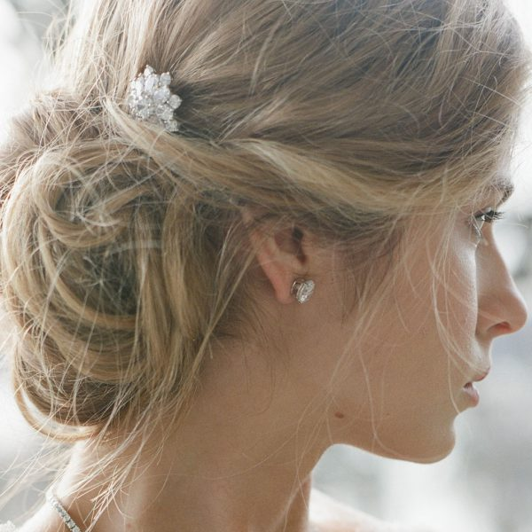 The Liz Garland Burst Hairpin is a brass and CZ hairpin from our Bridal Jewelry Collection seen here on model.