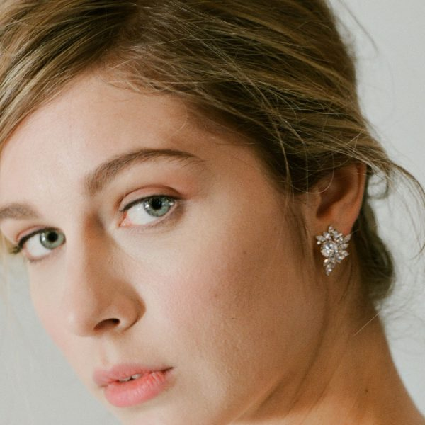 The Liz Garland Clusters are sterling silver and CZ earrings from our Signature Jewelry Bridal Jewelry and Evening Jewelry Collections seen here on model.