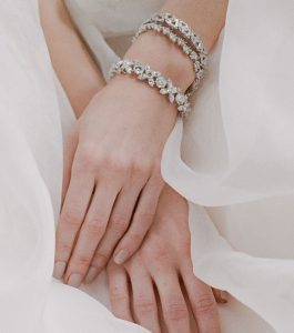 The Liz Garland Bracelet is a sterling silver and CZ bracelet from our Bridal Jewelry Collection seen here on model.