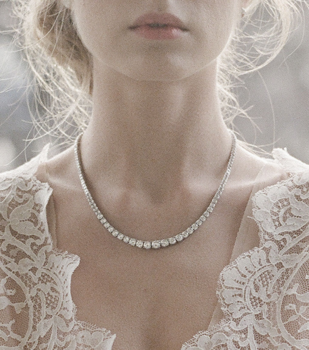 The Liz Round Riviera Necklace is a sterling silver and CZ necklace from our Signature Jewelry Bridal Jewelry and Evening Jewelry Collections seen here on model.
