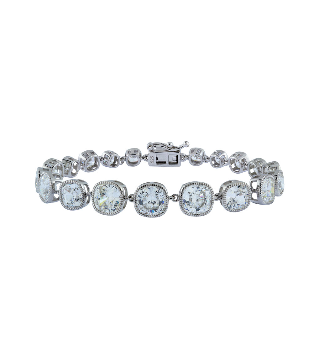 The Lucille Graduated Cushion Cut Bracelet is a sterling silver and CZ bracelet featured in our Signature Jewelry and Evening Jewelry Collections.