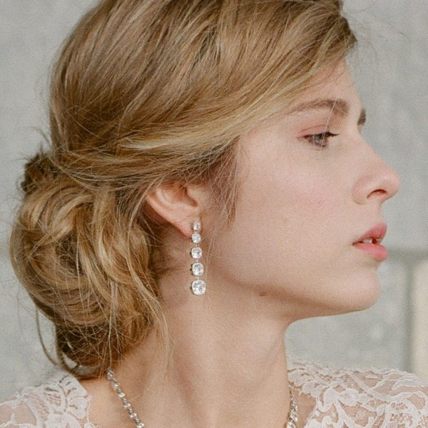 The Lucille Long Drops are sterling silver and CZ earrings from our Signature Jewelry and Evening Jewelry Collections seen here on model.