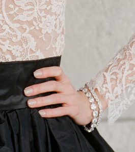 The Lucille mall Cushion Cut Bracelet is a sterling silver and CZ bracelet from our Signature Jewelry and Evening Jewelry Collections seen here on model.