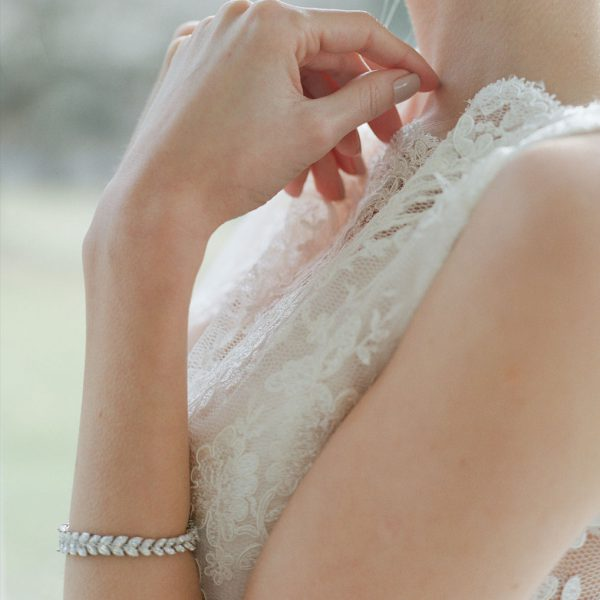 The Rita Graduated Marquise Bracelet is a sterling silver and CZ bracelet from our Bridal Jewelry Collection seen here on model.