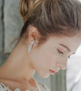 The Rita Marquise Burst Statement Earrings are sterling silver and CZ earrings from our Bridal Jewelry Collection seen here on model.