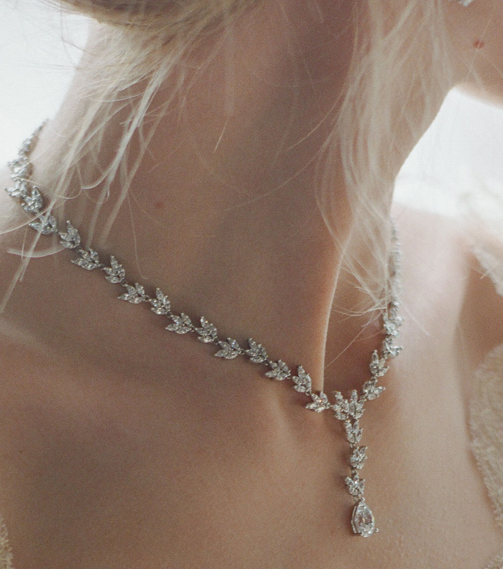 The Rita Marquise Drop Necklace is a sterling silver and CZ necklace from our Bridal Jewelry Collection seen here on model.