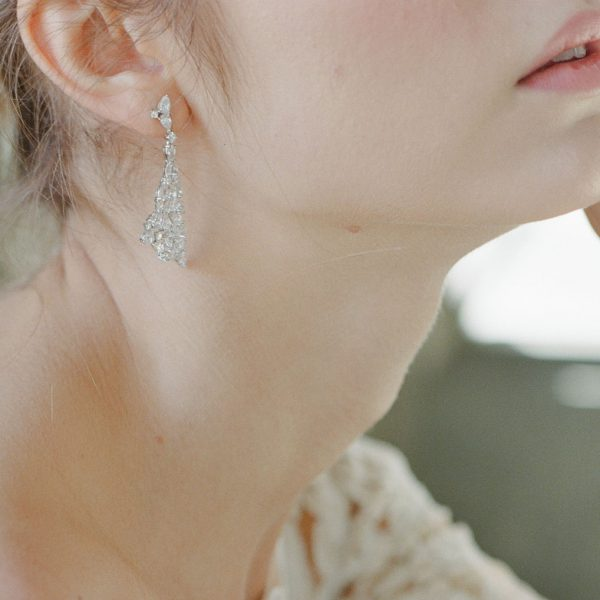 The Rita Statement Drops are sterling silver and CZ earrings from our Bridal Jewelry and Evening Jewelry Collections seen here on model.